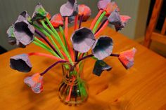 Painted cardboard egg cartons and pipe-cleaners....  tulips made by the kiddos!