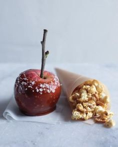Homemade caramel apples recipe, I love the idea of the twig for the stick, very cute >>