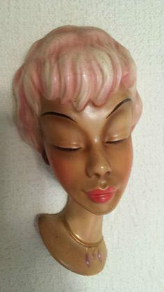 http://www.ebay.de/itm/Seltene-Wandmaske-Wandkopf-Cortendorf-1950-Goldscheider-/381195013835?pt=LH_DefaultDomain_77