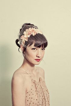 @Megan Walker and here's the other I'm considering - I could order it in ivory    Handmade flowers headband with birdcage veil overlay- style 120. $140.00, via Etsy.