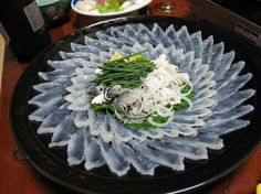 fugu (blowfish) sashimi!!! must eat this someday...