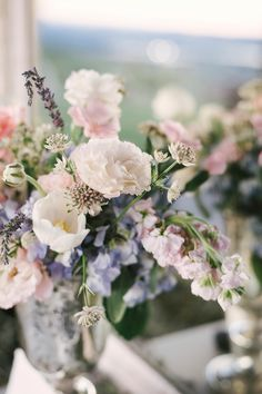 Use silver or mercury holders for your spring wedding flowers if your colors are pink, blue, white, cream, ivory or purple for a truly romantic and rustic chic look