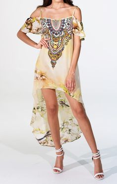 If you want all the drama without all the hassle of an elaborate train, you will love this dress. It's great to throw on if you want to grab a bite with your friends, or head to the beach for a quick dip. This luxury silk dress is everything you're looking for in designer beach wear. Simplicity, wearable, and fashion forward. #parides
