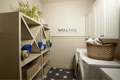 """laundry room.  love the """"X"""" shelving.  would be great in a bath.  HomeBunch blog - great design blog!"""