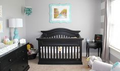 Neutral Baby Room - Loving the gray stripes on wall and teal picture frame accent