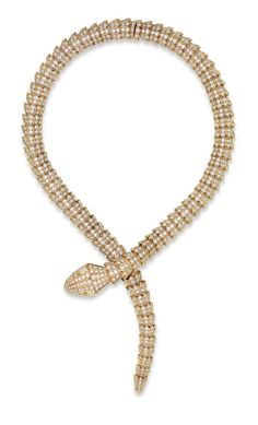 A DIAMOND 'SERPENTI' NECKLACE, BY BULGARI: Designed as an overlapping snake, with circular-cut diamond scales and pear-shaped diamond eyes, mounted in gold, 37.5 cm. Signed Bulgari, Italy, no. 9667. Via Christie's.