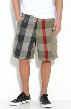 Burberry Brit - Mens plaid cargo shorts, white tee black leather tennis shoes with white soles.