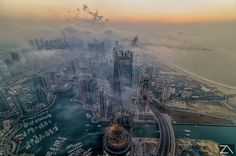 City above the clouds by Zohaib Anjum on 500px