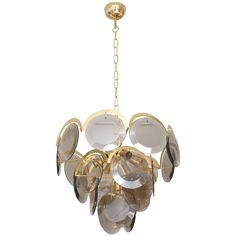 Mid-Century Modern Glass Chandelier, circa 1960s | From a unique collection of antique and modern chandeliers and pendants at https://www.1stdibs.com/furniture/lighting/chandeliers-pendant-lights/