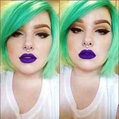 dramatic eye makeup, purple lips, and green hair