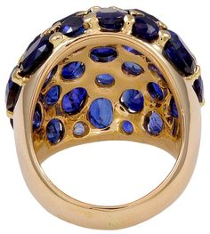 Rare Seaman Schepps Sapphire Gold Ring | From a unique collection of vintage cluster rings at https://www.1stdibs.com/jewelry/rings/cluster-rings/