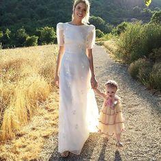 Elena Perminova on her wedding day walking with her baby