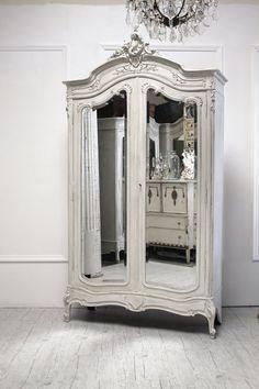 Antique armoire, for lack of closet space.