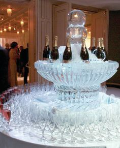 Is there anything more lavish than a champagne tower made of ice? This is one tradition we'll never get sick of.