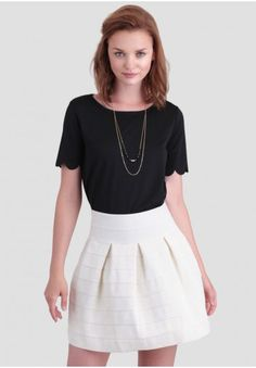 <p>A classic addition to any wardrobe, this white skirt features a bandage-style effect and ornate textured embroidery throughout. Finished with a back zipper closure and plenty of stretch, this chic and voluminous skirt pairs well with neutral colors for a classic look, or can be styled with a bright blouse for modern flare. Unlined but opaque.</p> <p>70% Polyester, 30% Spandex<br /> Imported<br /> 24
