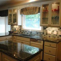 Kitchen Remodel with Soft Blue Cabinets and Glass Tile Backsplash by Hatchett Design/Remodel