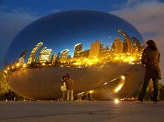 """Anish Kapoor's """"Cloud Gate,"""" aka """"The Bean,"""" located in Millennium Park. What an amazing way to take in the skyline!"""