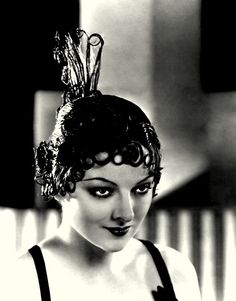 circa 1925: Myrna Loy (1905 - 1993), wearing a lacquered wig created by Dermott of London and called 'Speakeasy'.