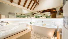 Pebbles around the bathtub