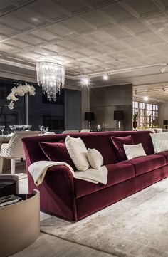 Bentley Home living room with elegant  bordeaux sofa combined with light accessories in Luxury Living Group new showroom, Miami 2014