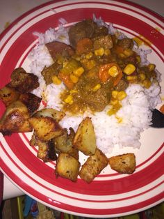 Beef stew: with sausages carrots celery and corn on top of white rice.  Roasted potatoes on the side