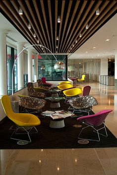 Guardian Office Reception by Davide Simonetti, via Flickr Break up the space between reception and office areas with slats