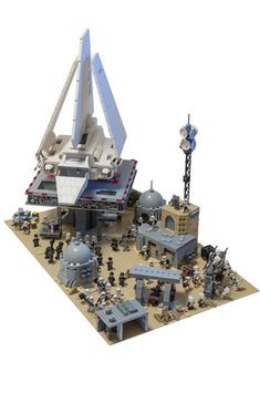 Imperial Shuttle Oversees The Operation At LEGO Tatooine Base Not just the landing pad and its anti-gravity elevators, but this whole custom LEGO Imperial base is awesome. And it shows how huge an Imperial Shuttle really is. Lego Krieg, Lego Mechs, Lego Star Wars, Legos, Van Lego, Lego Army, Lego Military, Lego Spaceship, Lego Pictures