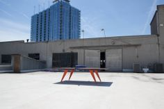 Table Tennis Court on the roof of the The Good Mod. Best Mods, Conference Table, Hardwood, Tennis, Design, Design Comics, Hardwood Floor