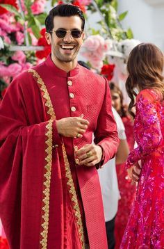 Who said grooms cant sport redlook at this dope groom Indian Wedding Clothes For Men, Wedding Kurta For Men, Best Wedding Suits, Wedding Dress Men, Wedding Sherwani, Indian Bridal Outfits, Wedding Bride, Dress Suits For Men, Men Dress