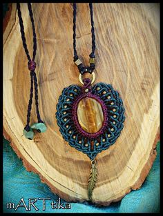 Pendant macramé with Tiger's eye and bronze accounts. by mARTtika