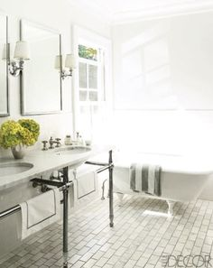bathrooms - claw-foot tub brick pattern tiles floor brushed nickel marble washstand double sinks white gray striped towel polished nickel sconces silver mirrors