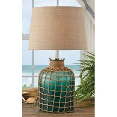 Houseboats decorate with nautical lamps such as the Sea Green Glass Lamp.