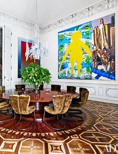 Works by Rob Pruitt (left) and Jeff Koons enliven the dining room, where the parquet floor is based on one in St. Petersburg's Pavlovsk Palace; Marc Newson designed the table and the chairs, which are upholstered in a Pierre Frey velvet.