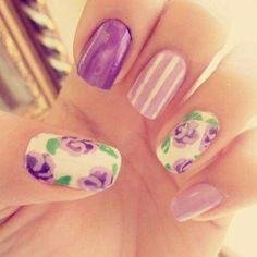 Lilac nails with flowers - Get this inspired look at Capricio Salon & Spa - Milwaukee, WI www.capriciosalon.com