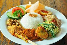Nasi campur (mix rice) Popular Balinese & Indonesian food. Bali, Indonesia, Wanderlust, Bucket List, Island, Paradise, Bali, Travel, Exotic Places, temple, places to visit in Bali.