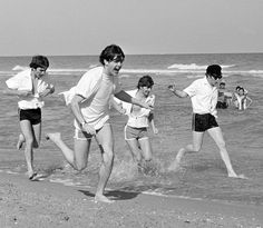 ♡ The Beatles ♡ The Beatles running on the beach in Miami, Florida, 1964.