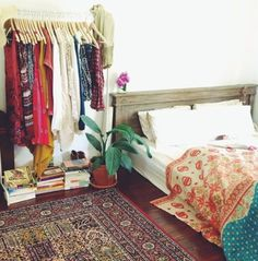 Bed on floor. Clothes Rack