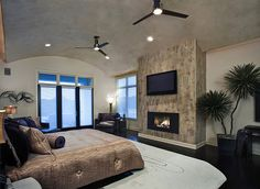 Bedroom fireplace and arched wall feature