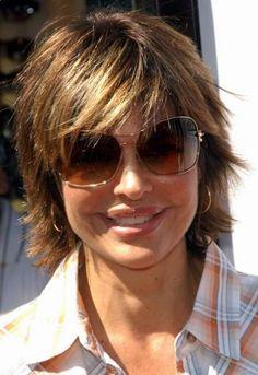 medium hair cuts | Lisa Rinna has short to medium, straight hair in a shag style with ...