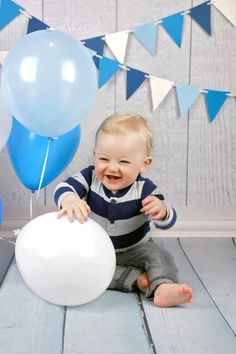 Happy first birthday!  This adorable little boy came in for a cake smash mini with white and blues for the theme.  Isn't he adorable?  Hayley June Photography, Calgary photographer, first birthday pictures, cake smash ideas, blue and white.