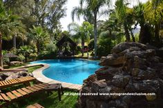 African style villa with a exotic pool + waterfall | Sotogrande. For more information :  http://www.sotograndexclusive.com/properties/villa-karibu-sotogrande-2/