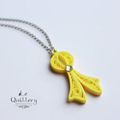 Love this quilled ribbon necklace :)