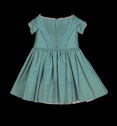 Circa 1860s child's dress: Wool twill, applied silk soutache braid trim, linen Valenciennes bobbin lace, glazed cotton plain weave, and brass hooks, via Museum of Fine Arts, Boston.
