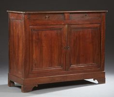 French Louis Philippe Carved Oak and Mahogany Sideboard, 19th c., the rounded corner top over two frieze drawers above double cupboard doors on a plinth base on bracket feet, H.- 43 1/4 in., W.- 54 1/2 in., D.- 21 1/2 in.
