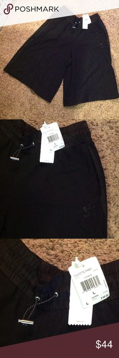 Adidas Culottes Shorts Brand new with tags, never worn, draw string shorts and zip pockets. adidas Shorts Athletic