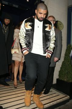 "Drake wearing  Timberland 6"" Basic Waterproof Boots, Grant Shop Sukajan Tiger Reversible Souvenir Jacket"
