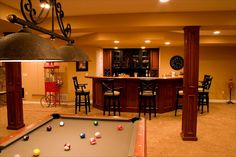 One half of the basement will be a game room with an open bar. The other half will be my studio..