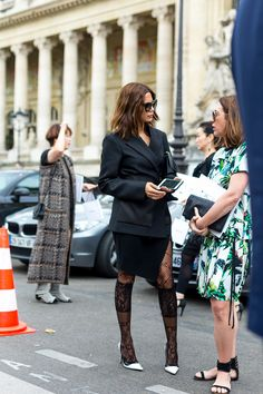 Couture Culture: The Best Street Style from Paris. Yes, to the suit with those nylons and white heels.