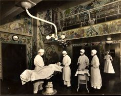 Murals cover the walls of the operating room at Barnes Hospital in the early 20th century. The walls were painted by a surgeon who wanted to give patients something to look at while they waited for their anesthesia.
