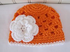 Cute & Kozy Crocheted Halloween Hat - Hot Orange with White Flower - (Size 0-3 Months) - Available in sizes Newborn to 12 Years. $14.00, via Etsy.